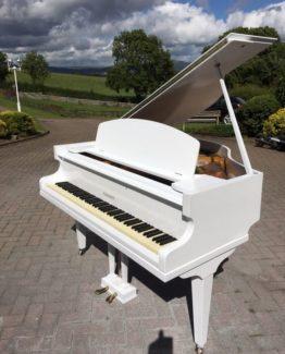 Challen white grand piano